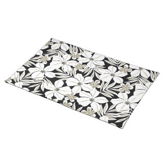 White tropical flowers on black placemat
