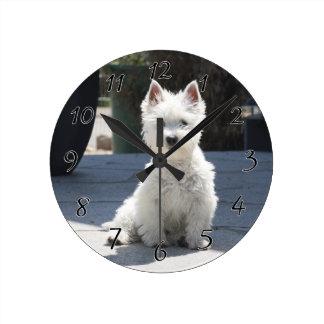 White West Highland Terrier Sitting on Sidewalk Round Clock