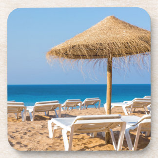 Wicker parasol with beach beds.JPG Coaster