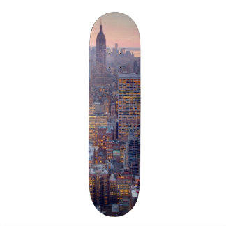 Wide view of Manhattan at sunset Skate Board
