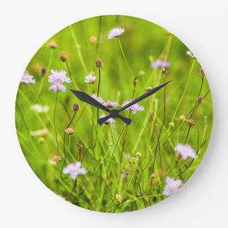 Wild flowers in the green meadow large clock