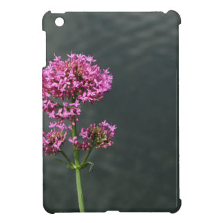 Wildflowers against the water surface of a river case for the iPad mini