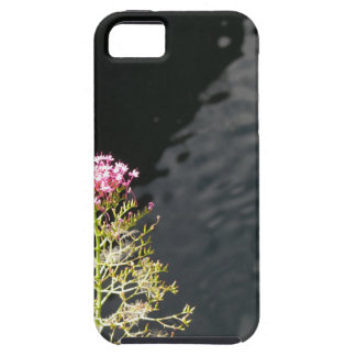 Wildflowers against the water surface of a river case for the iPhone 5
