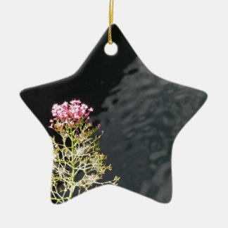 Wildflowers against the water surface of a river ceramic ornament