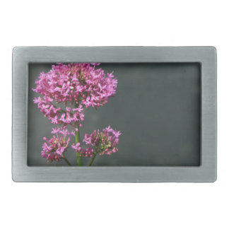 Wildflowers against the water surface of a river rectangular belt buckles
