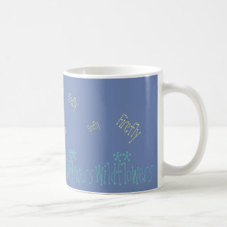 Wildflowers and fireflies against the evening sky coffee mug