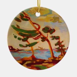 Wind-swept trees round ceramic ornament