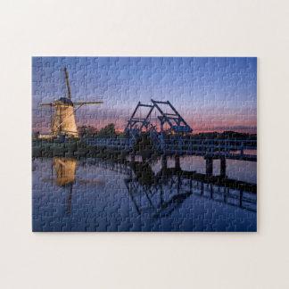 Windmill and a drawbridge at sunset jigsaw puzzle