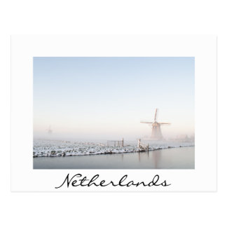 Windmill in the snow in winter white text postcard