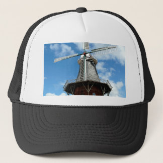 Windmill wing facing challenges bravely trucker hat
