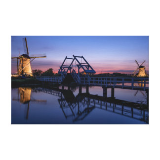 Windmills and a drawbridge at sunset canvas print