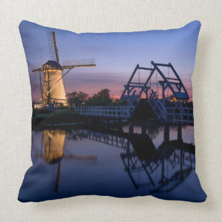 Windmills and a drawbridge at sunset pillow