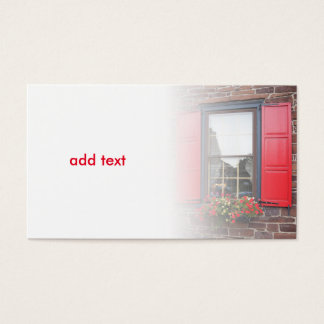 window with bright red shutters business card