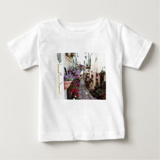 Windows, balcony and flower alleys in Spello Baby T-Shirt
