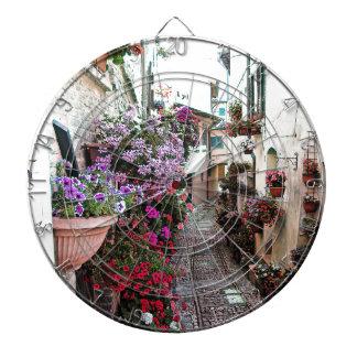 Windows, balcony and flower alleys in Spello Dartboard