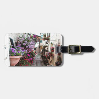 Windows, balcony and flower alleys in Spello Luggage Tag