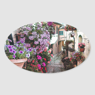 Windows, balcony and flower alleys in Spello Oval Sticker