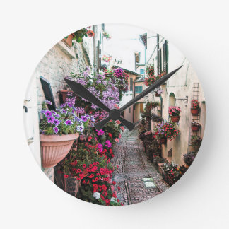 Windows, balcony and flower alleys in Spello Round Clock