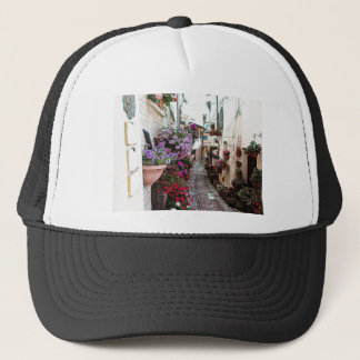 Windows, balcony and flower alleys in Spello Trucker Hat