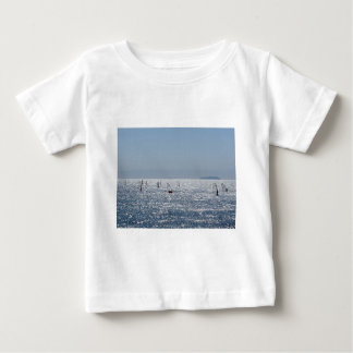 Windsurfing in the sea . Windsurfers silhouettes Baby T-Shirt