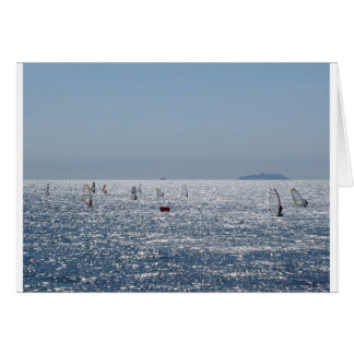 Windsurfing in the sea . Windsurfers silhouettes Card