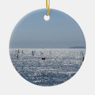 Windsurfing in the sea . Windsurfers silhouettes Ceramic Ornament