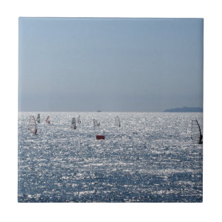 Windsurfing in the sea . Windsurfers silhouettes Ceramic Tile