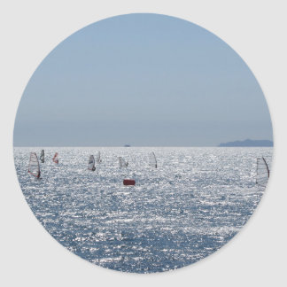 Windsurfing in the sea . Windsurfers silhouettes Classic Round Sticker