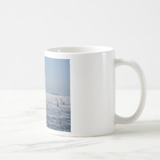 Windsurfing in the sea . Windsurfers silhouettes Coffee Mug
