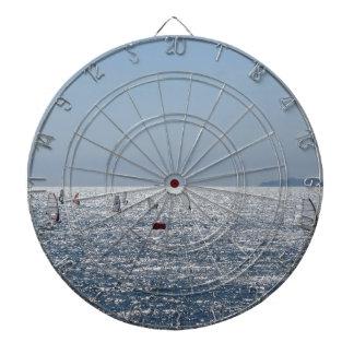 Windsurfing in the sea . Windsurfers silhouettes Dartboard