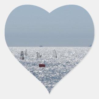 Windsurfing in the sea . Windsurfers silhouettes Heart Sticker