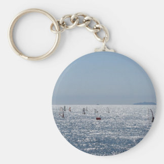 Windsurfing in the sea . Windsurfers silhouettes Keychain