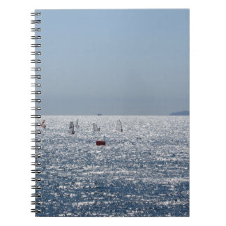 Windsurfing in the sea . Windsurfers silhouettes Notebook