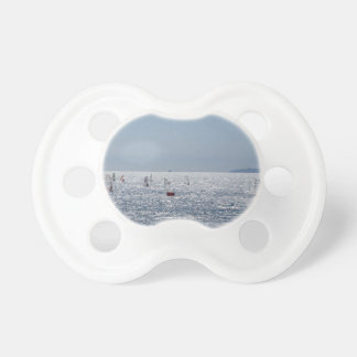 Windsurfing in the sea . Windsurfers silhouettes Pacifier