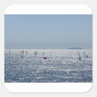 Windsurfing in the sea . Windsurfers silhouettes Square Sticker