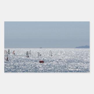 Windsurfing in the sea . Windsurfers silhouettes Sticker