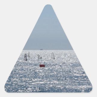 Windsurfing in the sea . Windsurfers silhouettes Triangle Sticker