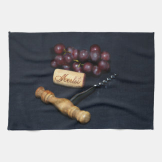 Wine bottle corks, corkscrew and grapes towels