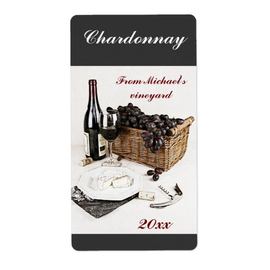 Wine bottle, wine glass, grapes and cheese label