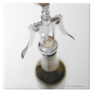 Wine bottle with corkscrew. tiles
