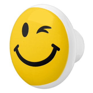 Winking smiley face ceramic knob