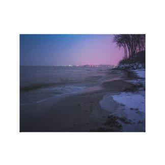 Winter dusk on the beach canvas print