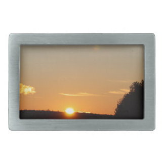 Winter Golden Sun Ray Reflects on Junior Lake Belt Buckle