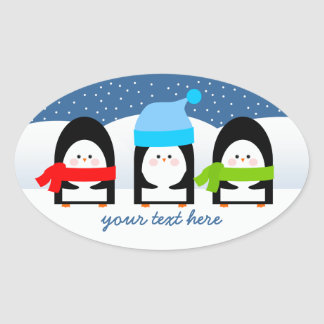 Winter Penguin Trio Snowy Night Oval Sticker
