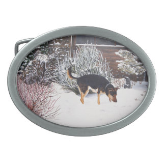 Winter snow scene with cute black and tan dog oval belt buckles