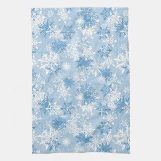 Winter snowflakes pattern on blue kitchen towel