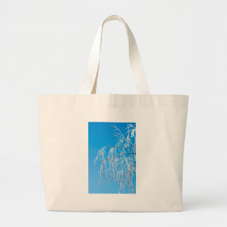 Winter tree branches covered with frost snow large tote bag
