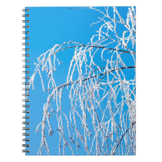 Winter tree branches covered with frost snow notebooks