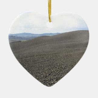 Winter Tuscany landscape with plowed fields Ceramic Heart Ornament