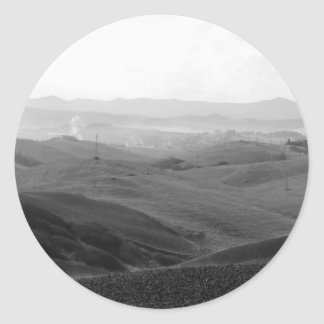 Winter Tuscany landscape with plowed fields Classic Round Sticker